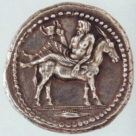 Αργυρό τετράδραχμο Μένδης Μακεδονίας, π.425π.Χ. Εμπροσθότυπος Διόνυσος καθήμενος ανάστροφα επάνω σε όνο